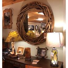 "50"" round teak-root wall mirror."