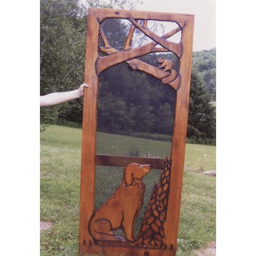 Handmade rustic wooden screen door featuring a dog and forest theme.