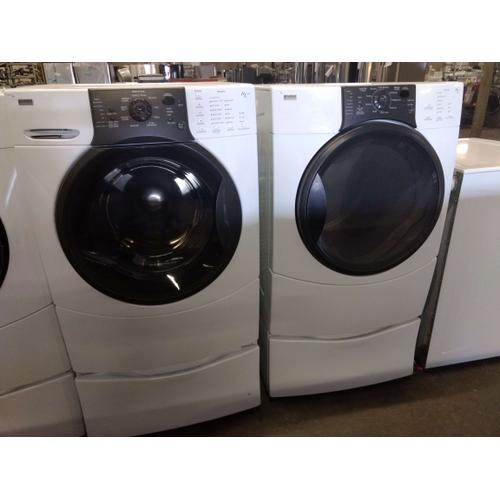 Refurbished White Kenmore Elite White Front Load Washer Dryer Set On Pedestals . Please call store if you would like additional pictures. This set carries our 6 month warranty, MANUFACTURER WARRANTY AND REBATES ARE NOT VALID (Sold only as a set)
