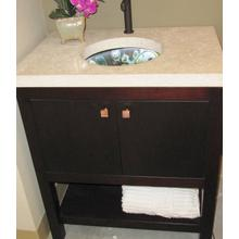 Custom cabinet with solid stone top and illuminated hand made glass sink