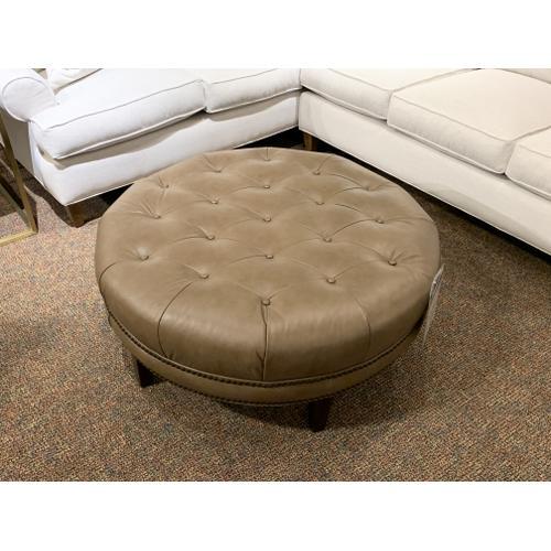 Tyndall Furniture & Mattress - Round Leather Ottoman with Nailhead Trim - Customizable