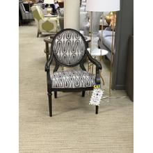 Black accent chair with gray and white details