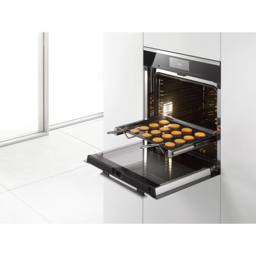 Handle For safe removal of hot, fully-loaded trays and racks.