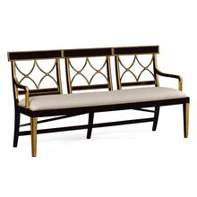 Three seater Regency ebony curved back bench, upholstered in Mazo