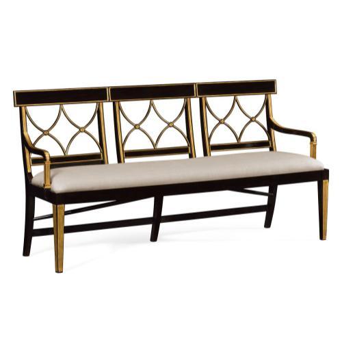 Three seater Regency ebony curved back bench, upholstered in Mazo