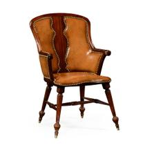 Walnut windsor splat back arm chair with brown leather