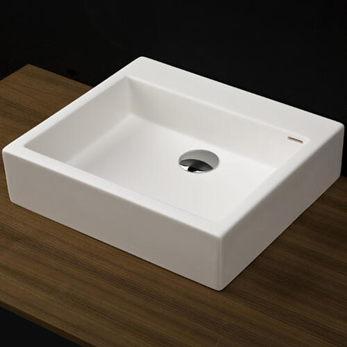 "Vessel Bathroom Sink made of solid surface, with an overflow.Finished back. Available with no faucet holes, one or three in 8"" spread.W: 22"" D: 15""H: 6 1/8"""
