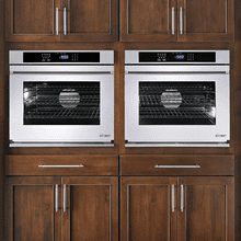 """Renaissance 30"""" Single Wall Oven in Black Glass with vertical stainless steel trim - ships with Millennia Style brushed stainless steel handle."""
