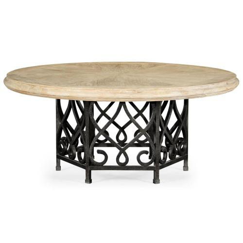 Limed wood dining table with wrought iron base