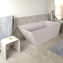 See Details - Free-standing soaking bathtub made of white solid surface with an overflow and polished chrome drain, net weight 440lbs, water capacity 112 gal.