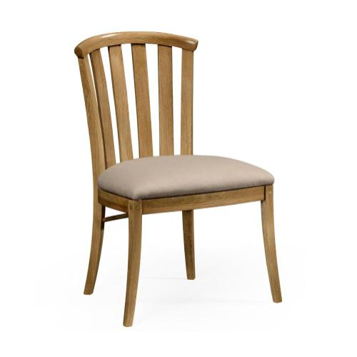 Light oak side chair with curved back
