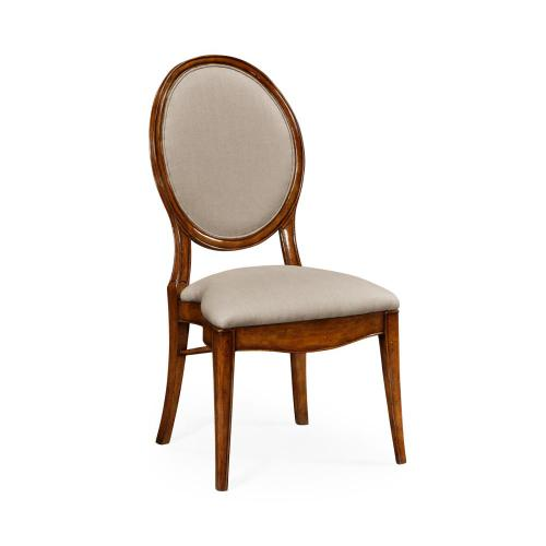 Spoon back upholstered stacking dining chair, upholstered in Mazo