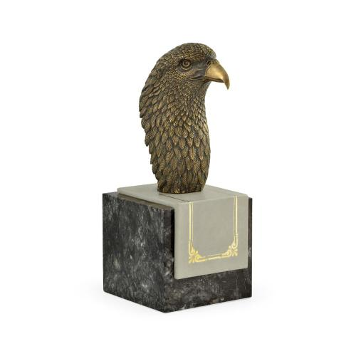 An intricate eagle on a marble stand
