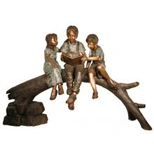 Three kids reading on log