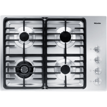 Gas cooktop with a dual wok burner for particularly wide ranging burner capacity.