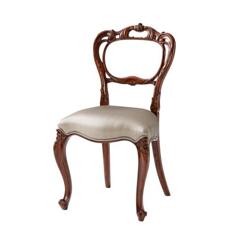A Fine Hand Carved Buckle Back Side Chair