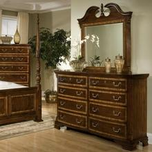 Eight Drawer Triple Dresser and Broken Pediment Landscape Mirror