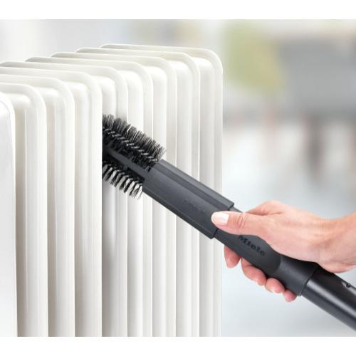 Radiator brush practical for cleaning difficult-to-reach areas.