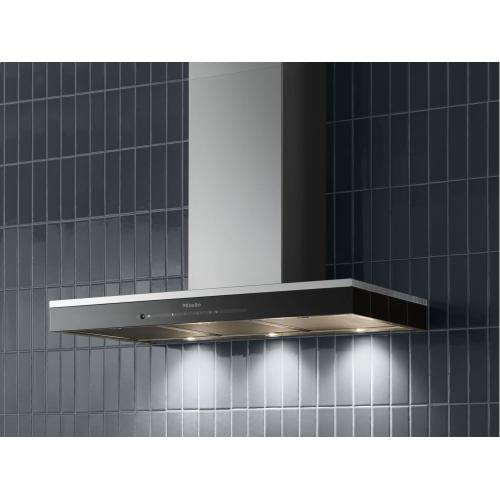 Wall ventilation hood with energy-efficient LED lighting and touch controls for simple operation.