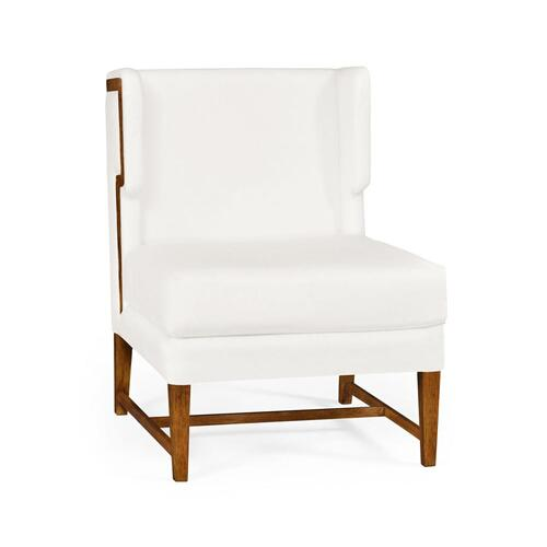Winged occasional chair upholstered in COM