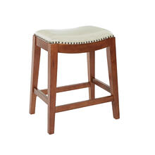 "Metro 24"" Saddle Stool With Nail Head Accents and Espresso Finish Legs With Cream Bonded Leather"