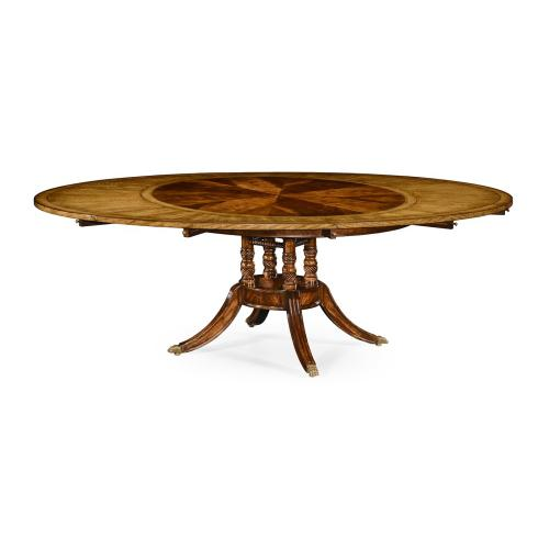 """53"""" Mahogany and satinwood round to oval dining table"""