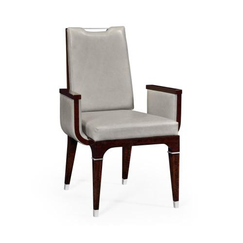 Upholstered armchair with stainless steel detailing
