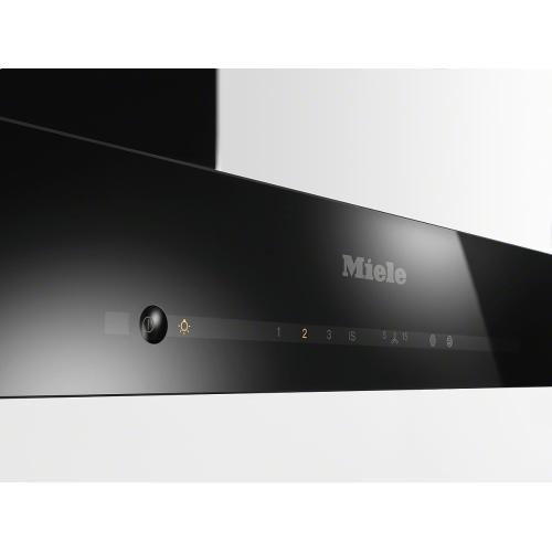Miele - DA 6690 W Puristic Edition 6000 AM Wall ventilation hood with energy-efficient LED lighting and touch controls for simple operation.