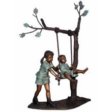 Girl puching boy on swing