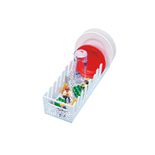 Multi-purpose dishwasher basket with separate areas for baby bottles and small items.