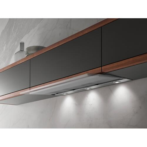 Built-in ventilation hood with motorized pull-out canopy for maximum convenience.
