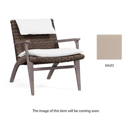 Outdoor occasional chair upholstered in Mazo