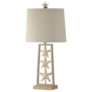 Coastal sand dollar table lamp in sandstone finish metal frame with natural linen shade