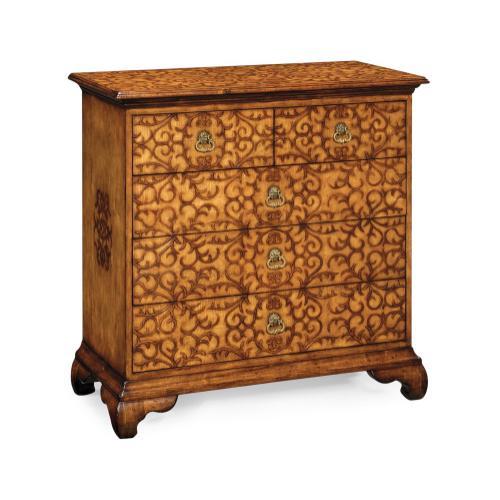 Walnut raised arabesques chest of drawers