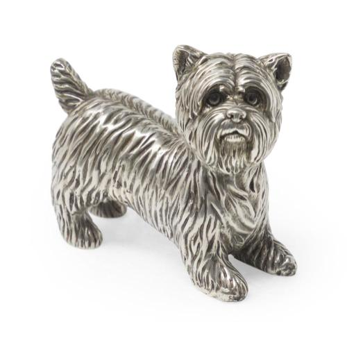 Yorkshire Terrier dog in antique white brass