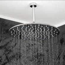 Ceiling-mount tilting round rain shower head, 330 rubber nozzles. Arm and flange sold separately.