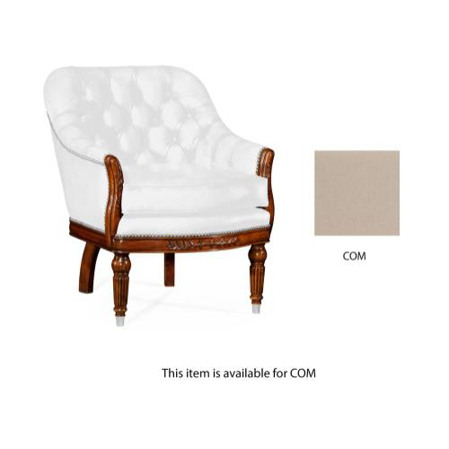 Mahogany club chair, upholstered in COM
