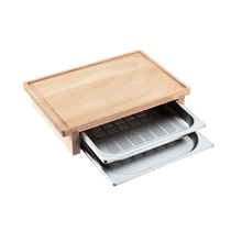 Carving board with 2 inserted steam cooking containers.