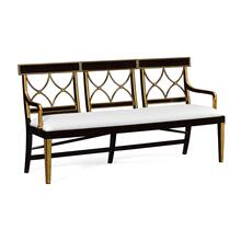 Three seater Regency ebony curved back bench, upholstered in COM