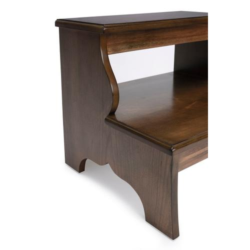 """This traditionally styled bed step keeps everything within reach, and its sturdy construction is a """"step-up """" from other options. Crafted from select hardwood solids and wood products, it features a charming distressed finish over cherry veneers. Beyon"""