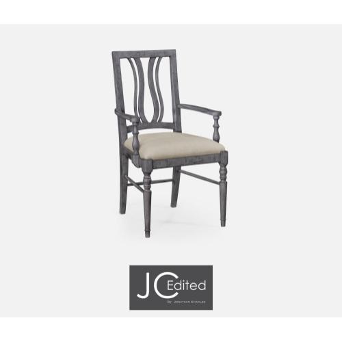 Upholstered armchair in antique dark grey