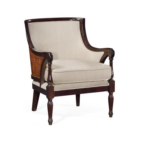 Armchair with rounded back and carved front legs, upholstered in MAZO