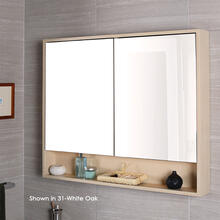 Surface-mount medicine cabinet with two mirrored doors, two adjustable glass shelves in each section and LED lights in cubby.