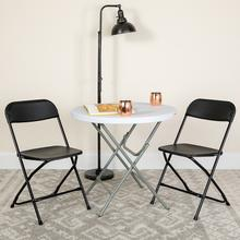 View Product - Hercules™ Series Plastic Folding Chair - Black - 650LB Weight Capacity Comfortable Event Chair - Lightweight Folding Chair -