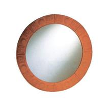 New Generation large, round mirror with an embossed terra cotta border.