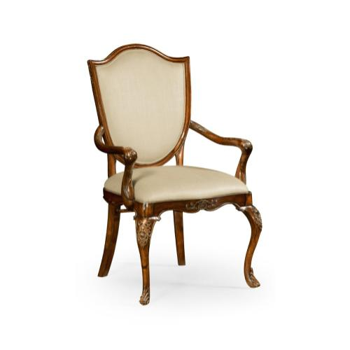 Shield back mahogany armchair with medium antique chestnut leather in Mazo