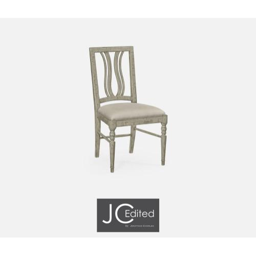 Upholstered side chair in rustic grey