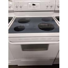 White Frigidaire Glass Top Range  (This may be a Stock Photo, actual unit (s) appearance may contain cosmetic blemishes. Please call store if you would like additional pictures). This unit carries our 6 Month warranty, MANUFACTURER WARRANTY and REBATE NOT VALID with this item. ISI 36299 W