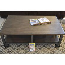 Product Image - Ashley Furniture wood and metal wheeled rustic cocktail table.