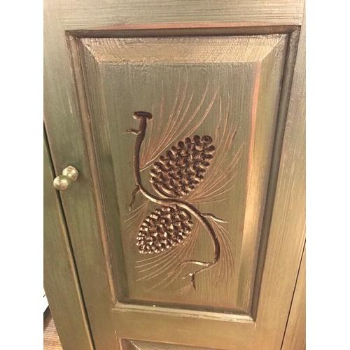 Jelly cabinet with pine cone theme.